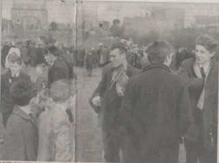 A RARE photograph of the legendary fiddle player Paddy Rainey, taken at Milltown Races. There is a Rainey family (Paddy, Stephen and Bridie) traditional music CD available, from an original recording in a Connemara pub in 1956. The Raineys were a family of Galway travellers who spent their summers in the Letterfrack area and their winters in North-East Galway. They were recorded while in Connemara by Professor Tony Knowland, an authority on WB Yeats and passionately interested in folk music. | Peter Brennan