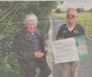 Tony Murphy and Frank Glynn replace a sign which was vandalised in Milltown.   Ray Ryan