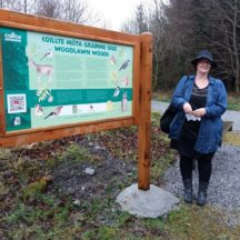 Carrie O' Sullivan, Artist with Nature Trail Sign