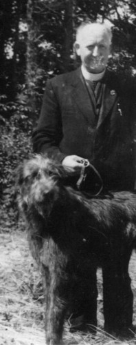Fr John Fahy with his Irish wolfhound Bran. | Photo courtesy  Joan Larkin