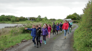Children from Cloughanover NS on a meadow walk | Marina Levitina