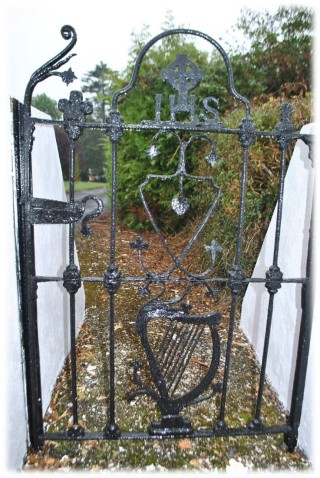 Gate with cast iron finials made by T. Clarke.