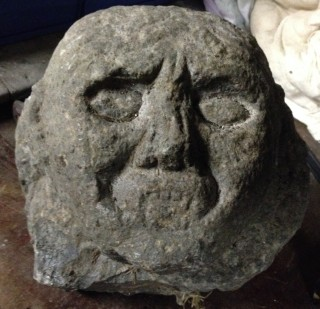 Grotesque face in relief   Christy Cunniffe