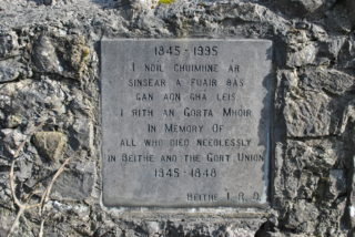Limestone commemorative plaque erected by Beagh IRD. | Christy Cunniffe