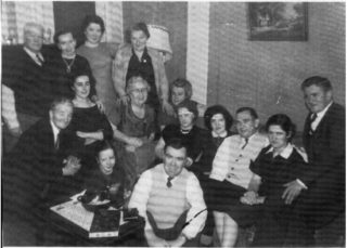 Back L. to R. Tommy Sheridan, Mrs. Connors, Margaret McClearn (Heathlawn), May Fitzpatrick/Murray (Killimor), Middle: Jim (James) Murray, Anna McClearn (Heathlawn), Florence Gilchrist (whose mother was Hara from Neale), Mrs. Sheridan (formerly Gertie Keary, Kylemore), A. N. Other, Margaret Treacy (Heathlawn), Johnny Connors, Winnie Treacy (Heathlawn), Joe Tierney (Heathlawn), Front: Mary Murray, Pakie Grady (Neale).