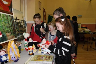 Children casting an envious glance at the knitted dolls during Heritage Exhibition as part of the first celebration of Culture Day on 20th September, 2013 | Photo: Bernadette Connolly, Clogher boy