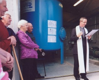 Fr. Tod blessing new treatment plant.
