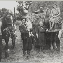 L-r: Ned Mullen, Ned's nephew Johnny Maloney, Baby John Maloney, Ban Hughes, Daisy Hughes and two visitors home for the summer (photo taken in the 1930s) | Out and About Magazine 2004