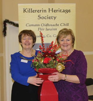 Eileen O'Connell,Secretary, (on right) presenting chairperson Bernadette Forde with an arrangement of flowers to mark the Book Launch | Source: Bernadette Connolly, Clogherboy (Barnaderg Community Centre, 18th December, 2015)