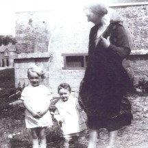 Mrs. McHugh with her two children at Market House