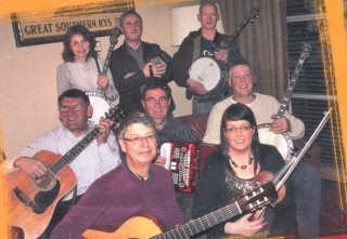 Peter Carey, 2nd row 1st left with members of Tuesday Trad session in Lowry's Clifden | Photo: taken from back of CD in aid of Galway Hospice