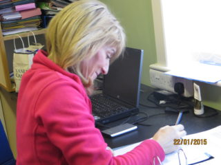 Rosaleen Molloy in parish office working on Parish History | Photo: Bernadette Forde, Togher