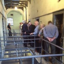 Tour guide showing Tour group, the prison. | Photo: B. Forde
