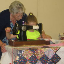 Eileen Reynolds, Cloonlusk, teaching Sarah Ahern Togher, how to do patchwork | Photo: Bernadette Forde