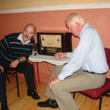 L-r: Noel McGrath and John Tighe, recalling past times during Heritage Exhibition 2009 in Killererin Community Centre | Photo: Bernadette Connolly