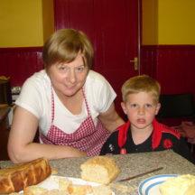 Margaret Tighe demonstrating breadmaking skills in Barnaderg Community Centre, 2009 | Photo: Bernadette Forde