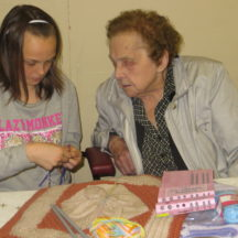 Rebecca learns to knit taught by Mary Nolan | Photo: Bernadette Forde