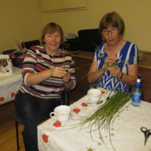 Mary and Brid learning how to make St. Brigid's crosses, during our Bealtaine Festival in Barnaderg Community Centre. | Photo Bernadette Forde