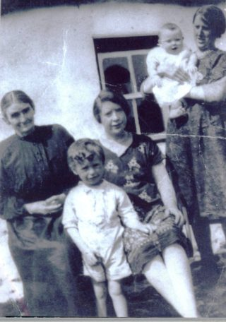 Mary Morrow, Lavally, standing her sister Maggie, her daughter Catherine and two grandchildren Michael O'Connor and Peggie O'Connor.  (c.1930) | Photo: courtesy of Geraldine O'Connor, Peak