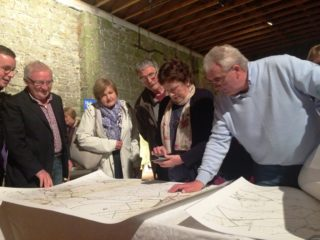 Poring over old maps of the area at event held in the Store Room of Ballyglunin Station during heritage week, August, 2017 | Photo: Ballyglunin Restoration Committee - courtesy of Mark Gibson