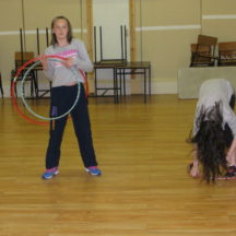 Rebecca and Alina Rooney ltrying to master the hoola hoop in Barnaderg Community Centre, during Bealtaine Festival | Photo: Bernadette Forde