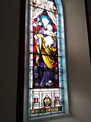 (South facing, right of altar) St. Joseph stained glass window (donor : Rev. Patrick McAlpine C.C. 1897). | Ray McGrath