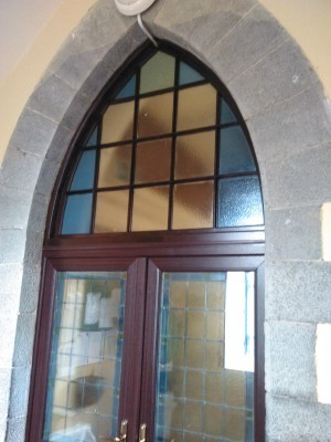 Cut stone archway over inside entrance door. | Ray McGrath