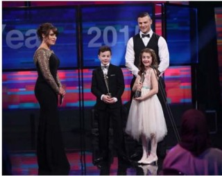 Aoibheann Mangan and Padraic Godwin, winners of the Young Person of the Year Award receive their awards from Irish Rugby Player Robbie Henshaw and Grainne Seoige   Photo: Robbie Reynolds