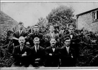 England 1927.  It shows a group of men, at least three of whom were from Cloonagh.  (William McGrath; John Larkin and his son Patrick Larkin).  There are also believed to be two or possibly three of the Joyces (relatives of the late Mai Nestor, nee Joyce, of Russelstown) in the picture too.  At Back: Unknown; _____ Joyce: Patrick Larkin;_____ Joyce?  Front: Unknown; William McGrath; John Larkin;_____ Joyce.  | RM