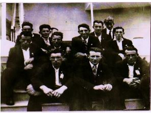 Taken at the Catholic Truth Society's Congress, Tuam June 1936, a group of young men who attended, most of whom were from Cloonagh. They are sitting on the steps of the main altar area at the rear of The Cathedral of the Assumption, Tuam. From left to right (at back): Michael Noonan, behind him - unknown, Raymond McGrath, Michael (Towrey) Kenny, Patrick Larkin, Bill McGrath, next to him - unknown, and Cyril Lavelle - (glasses). (In front): Paddy O' Donnell - (Knock, Milltown) Michael Flaherty and Thomas (Murty) Corley. | The photograph was taken by the late Mrs. Delia Connolly (nee McGrath) formerly of Cloonagh and Boston U.S.A.