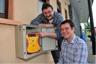 Help is only minutes away: Chairman of the Milltown AED group Padraig Coyne and Secretary Charles Carne | Photo by Ray Ryan