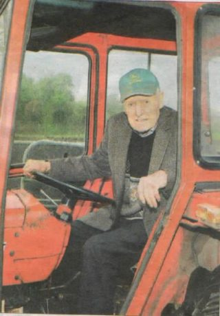 Jim Burke-Daly aged 100 on his tractor.