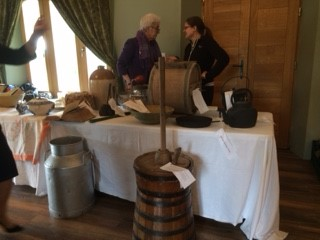 Margaret and Pauline discussing how to make butter | Deirdre McDonnell