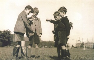 """1953 photo showing Frank Peters (left) who has just made a strike on Eamonn Ashe's conker as Paul O'Flynn and Eoin Ó Dochartaigh look on. This is one of the many images in a book """"The Jes, 150 Years of the Jesuits in Galway 1862 – 2012"""" 