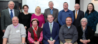 Moycullen Historical Society Committee 2017/2018 with Minister of State Sean Kyne TD. Back Row L to R:  Tim Griffin, Tara De Renzy, Hazel Morrison-Pagett, Joe Loughnane, Richard Long, Walter McDonagh, Mary Ann Feeney.  Front Row L to R:  Tomas O'Cadhain, Miriam McKiernan, Minister of State Sean Kyne TD, Mark McNally, Mary O'Shea.  Missing from photo Michael Baker, Maire Baker. | Sean Lydon
