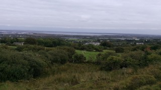 Panoramic View from Leaba Diarmuid, Gortyloughlin, looking down over Moycullen Village, Ballyquirke Lake and Lough Corrib towards Galway City. | Hazel Morrison