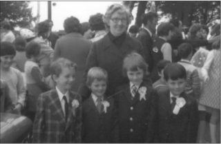 May 1979 Outside Moycullen Church Nell Greene with First Holy Communion Students Willie Cooke, Michael McDonagh, Aidan Keady and Kieran Hannon | Michael Baker