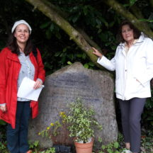 Annie Faherty O'Brien and her daughter Catherine O'Brien Wall at John Geoghegan Memorial Stone in Killagoola | Moycullen Historical Society