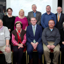 Moycullen Historical Society Committee with Minister of State Sean Kyne TD.  Back Row L to R  Tim Griffin, Tara De Renzy, Hazel Morrison-Pagett, Joe Loughnane, Richard Long, Walter McDonagh, Mary Ann Feeney.  Front Row L to R:  Tomas O'Cadhain, Miriam McKiernan, Minister of State Sean Kyne TD, Mark McNally, Mary O'Shea.