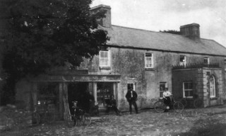 Today it's Ruanes Pub. When this photograph was taken it was The Central House or The Stage Coace Inn. At this tiome the name above the door was P Lyons