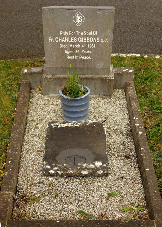 The final resting place and headstone of Fr Charles Gibbons CC DD. This is not the original stone - it has been lifted and just left back in the centre of the grave facing the wrong way and it's sad that DD has been omitted from the new stone as this was very important to Fr Charlie and caused much controversy in his lifetime. | © Gerry Costello Photography
