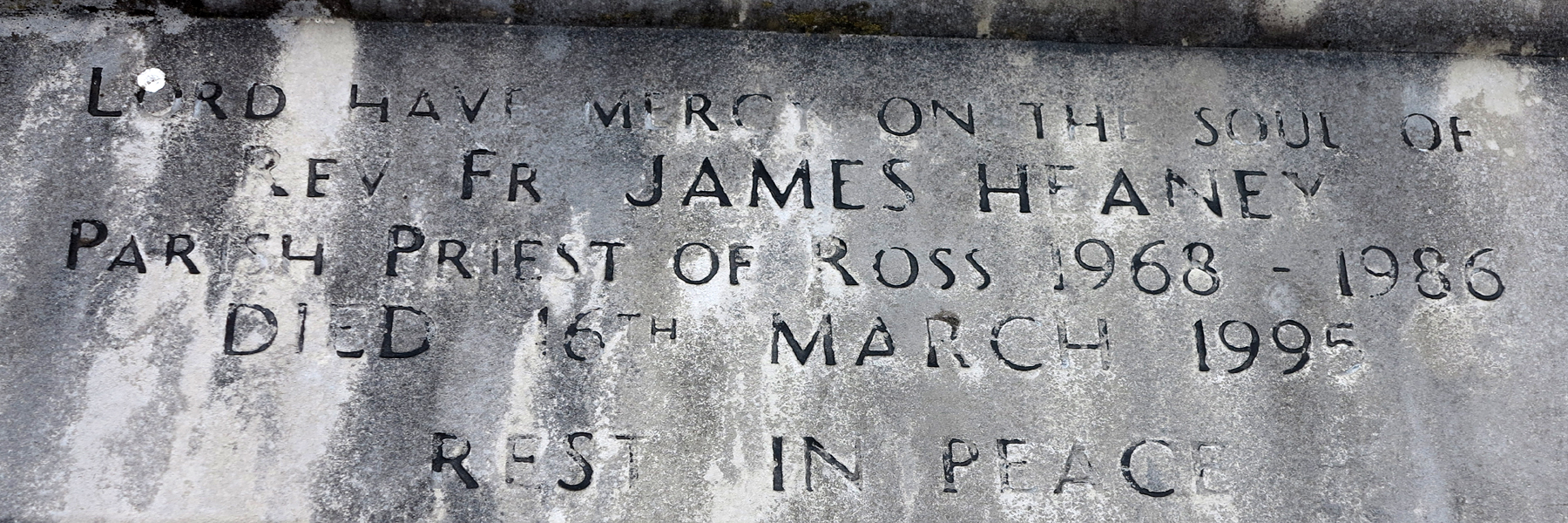 The Gravestone inscription for Fr James Heaney in Clonbur Church Grounds. - © Gerry Costello Photography