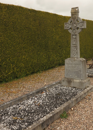 Final Resting Place and Headstone of Fr Patrick Joyce in Corrofin Church | © Gerry Costello Photography