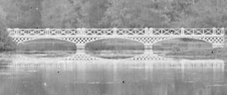 Close up of the White Bridge at Woodlawn with its reflection in the lake | Dillon Family, Courtesy of National Library of Ireland