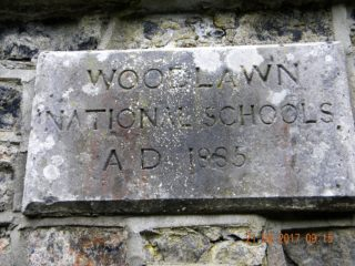 The old national school plaque depicts the school was opened in 1885. | Rosemarie Clavin