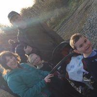 Family enjoying the sun_n   M. Kenny
