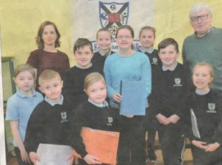 Teacher Sandra Burke with Pauline Connolly and Tony Murphy and pupils who worked on the Milltown Heritage Project.
