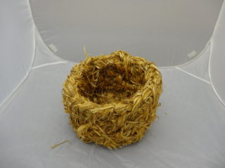 A modern, straw-made copy of an egg basket.  | MHG