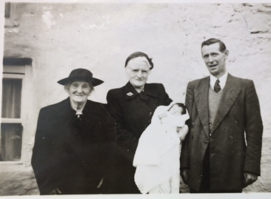 Margaret Boyle's christening (November 1929). Left Mrs Slattery village nurse, name unknown holding Margaret nicknamed Babs, James Francis Slattery | (C) of Sheron Boyle