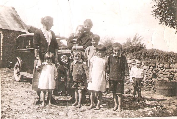 The Boyle Family early 1930s - Margaret Boyle cuddling Jimmy while her sister Bridget Huane holds Philomena, then Sean, Mary (middle row), Margaret, Michael, and cousin Tom Martin.  | (C) Sheron Boyle Media